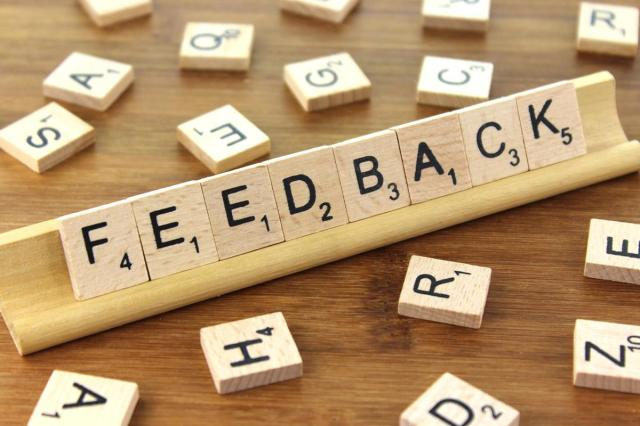 "scrabble tiles spelling the word ""Feedback"""